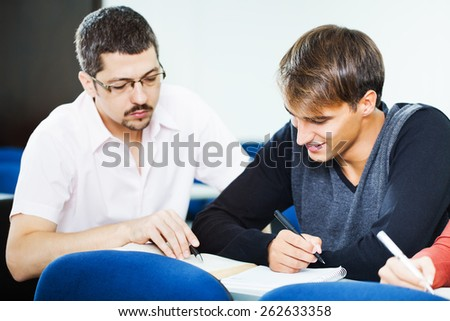 Student getting lecture from professor  - stock photo