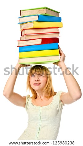 Student girl holding stack color books over the head. Isolated over white.