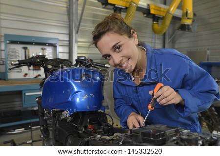 Student girl in motorbike mechanics - stock photo