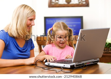 Student: Girl Leaning To Use The Internet And Laptop - stock photo