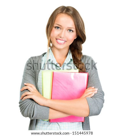 Student Girl Portrait. Cute Young Attractive Teenage Girl Holding Colorful Exercise Books. Isolated on White Background. University or High School Student Smiling. Education Concept  - stock photo