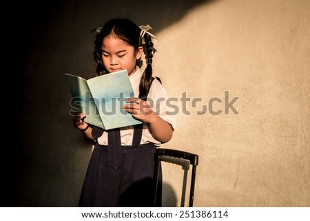 Student girl reading from her book in the evening - stock photo