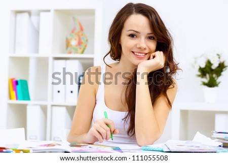 Student girl studying her lessons at home - stock photo