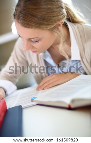 Student girl studying in business school
