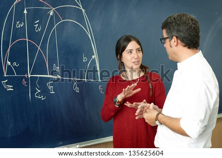 Student girl talking with professor - stock photo
