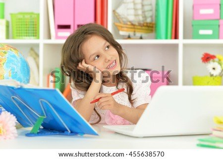 student girl  with book and laptop