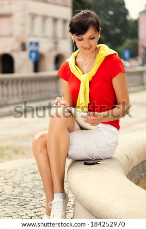 student girl with MP3,  in the city - stock photo