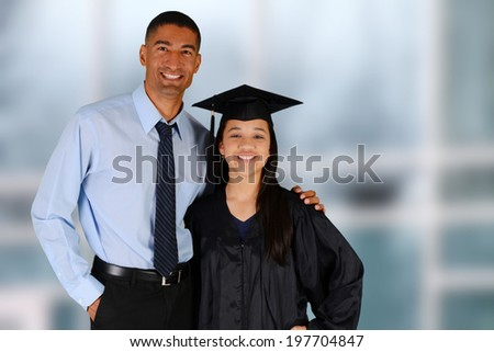 Student graduating standing by her teacher at school