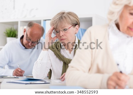 Student having headache during writing an exam