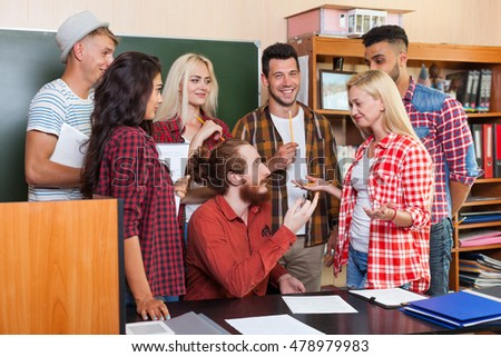 Student High School Group Talking With Professor Sitting At Desk, Young People Teacher Discuss Communicate University Classroom