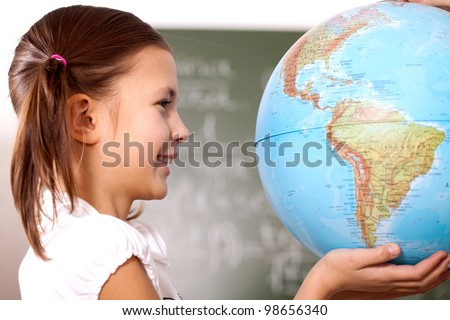 student holding a globe on the palms