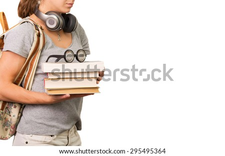 Student holding stack of books and reading glasses - stock photo