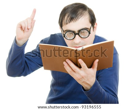 Student in glasses reading a book on white background - stock photo
