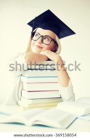student in graduation cap - stock photo