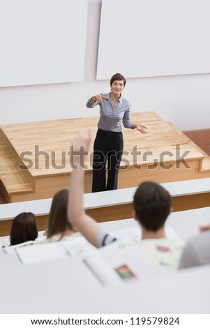 Student is asking question in lecture - stock photo