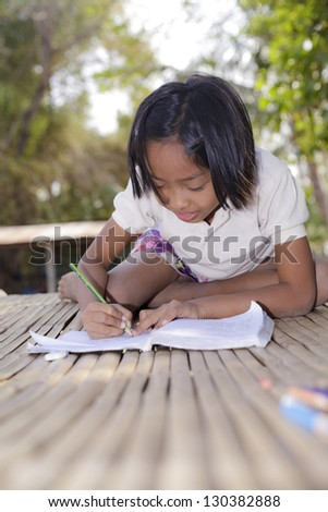 Student little asian girl, countryside in Thailand - stock photo
