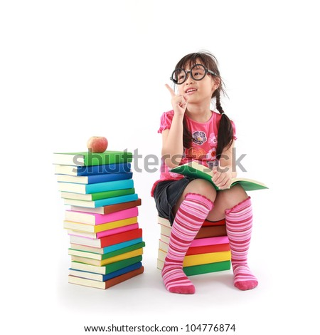 student little asian girl reading a book - stock photo