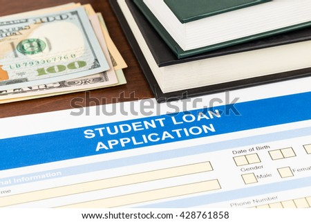 Student loan application form with dollar banknote, and text book - stock photo