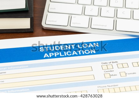 Student loan application form with keyboard, and text book