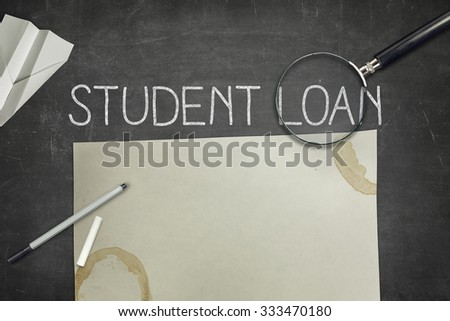 Student loan concept on blackboard with pen - stock photo