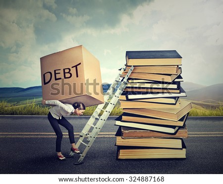Student loan debt concept. Young woman with heavy box full of debt carrying it up the education ladder  - stock photo