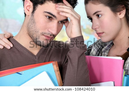Student offering support to a stressed friend - stock photo
