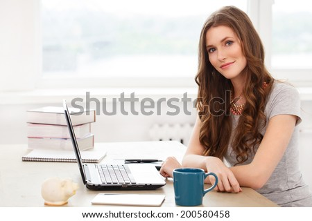 Student, office. Cute, beautiful woman by the table