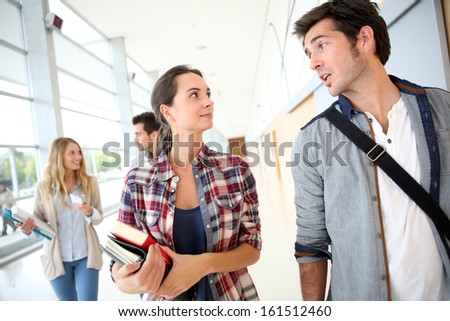 Student people walking in college hallway - stock photo
