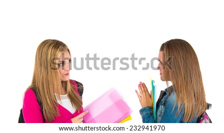 Student pleading at her friend over white background - stock photo