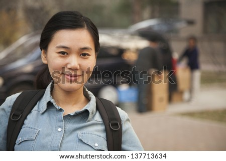 Student portrait in front of dormitory at college - stock photo