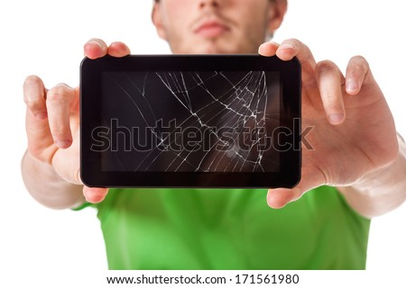 Student presenting a broken black tablet behind glass - stock photo