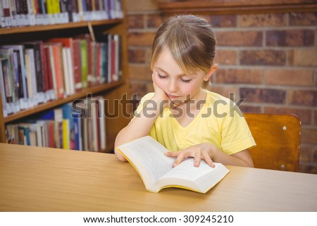 Student reading a book at the elementary school