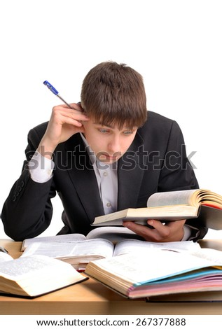 Student reading at the School Desk on the White Background - stock photo