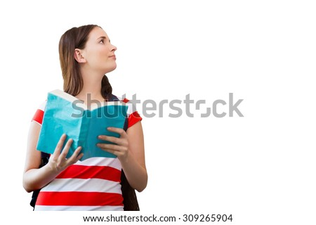 Student reading book in library against white background with vignette - stock photo