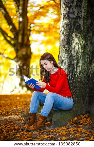 Student reading book outdoor