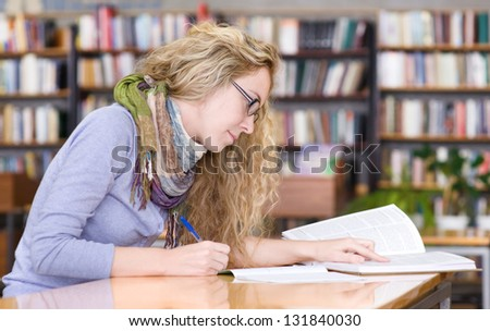 student reads the book in library
