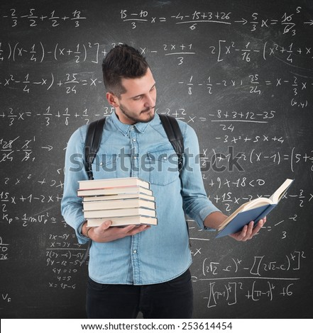 Student reads the lesson in the classroom - stock photo
