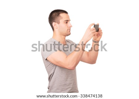 Student shooting photo by smartphone. Isolated on white background.