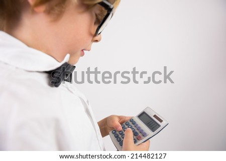 Student smiling and holding calculator on white background
