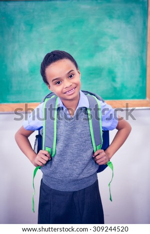 Student smiling and wearing a school bag at the elementary school