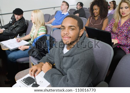 Student smiling with other students - stock photo