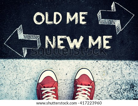 Student standing above the new and old me sign,dilemma concept  - stock photo