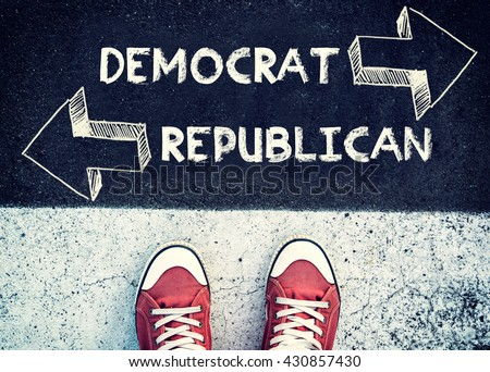 Student standing above the sign democrat and republican - stock photo