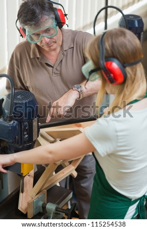 Student standing at a machine working - stock photo