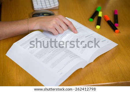 Student studying in the library at the university - stock photo