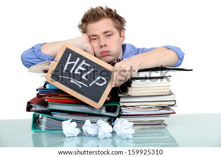 student swamped under work - stock photo