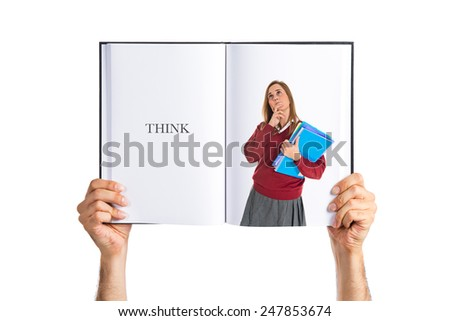 Student thinking printed on book - stock photo