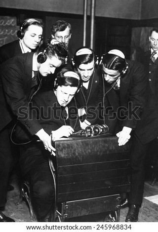 Student transmitting a message to four of his classmates in a radio class at the Stuyvesant Evening High School, N.Y. The Federal Vocational Board trained young men for radio work. WWI. April 1918.