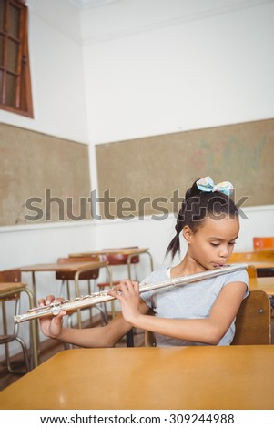 Student using a flute in class at the elementary school