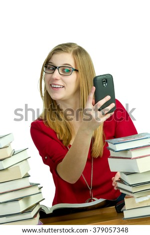 Student using cellphone instead of studying - stock photo